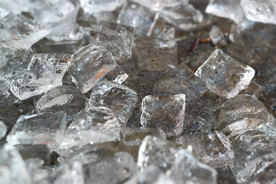 Ice cubes to represent putting an ice pack on the back to relieve sciatica pain.