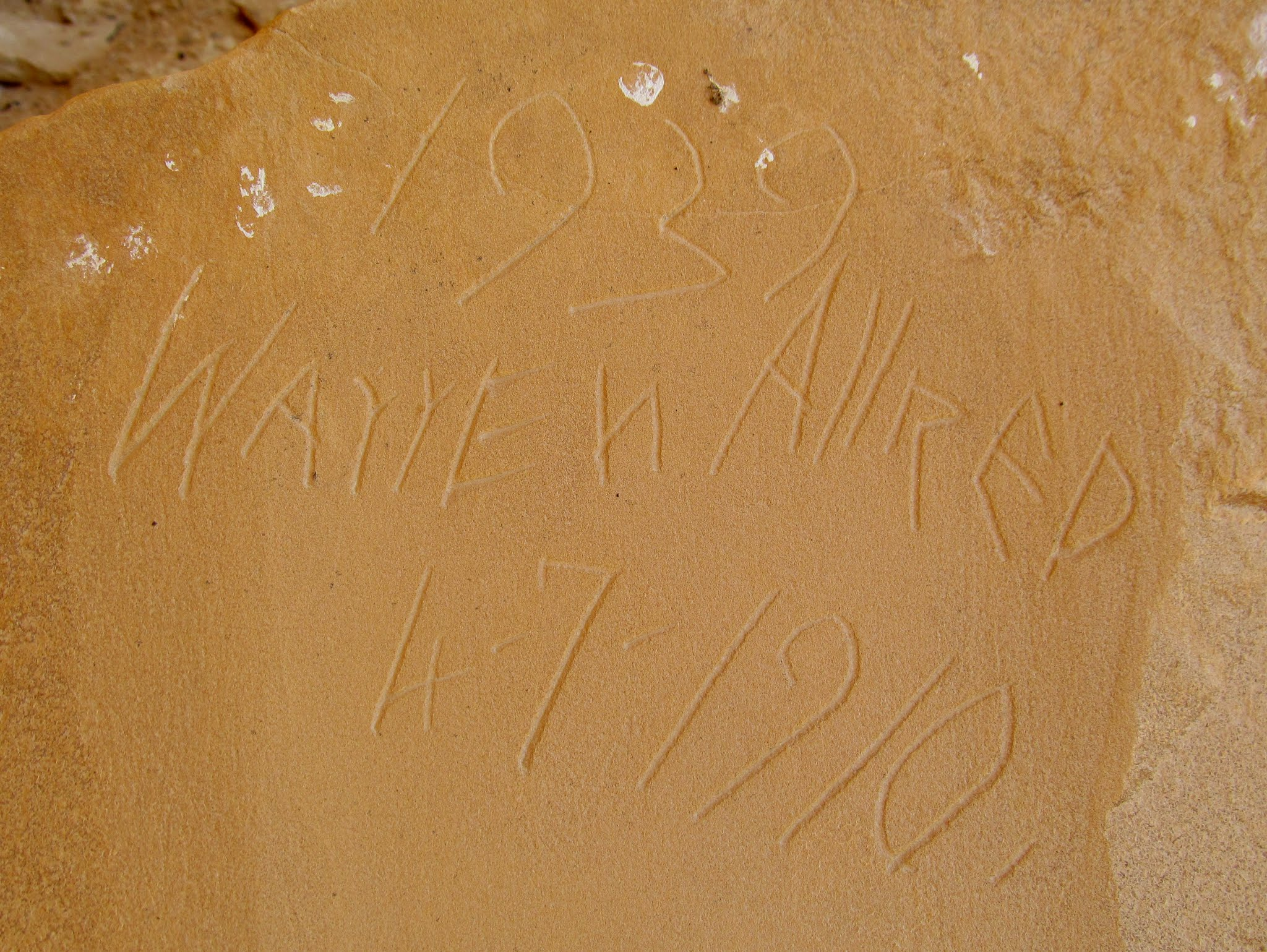 Photo: Warren Allred inscription in a boulder metate, with 1910 and 1939 dates