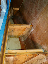Photo: oak cleats bolted and epoxied on to new bulkheads under pilot berth