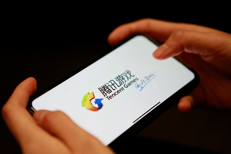 A Tencent Games logo from an app is seen on a cellphone. Picture: REUTERS/FLORENCE LO/ILLUSTRATION