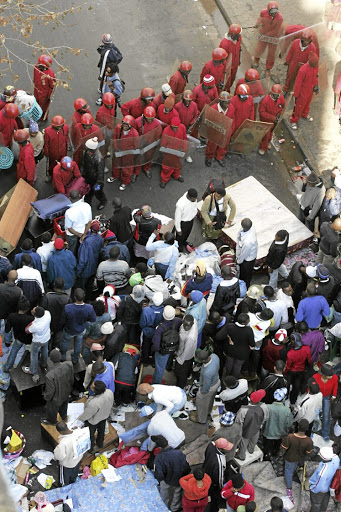In need of a home: The Red Ants oversee evictions in the Joburg CBD. The metro council and NGOs representing poor residents are at odds over an act that will bring relief to property owners. Picture: ANTONIO MUCHAVE