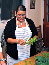 Photo: Nichole pulling holy basil leaves