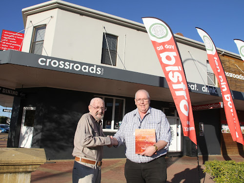 Historian John Brooks, left, with The Crossroads Hotel proprietor David Hamel who will put a copy of  Mr Brooks' 'Narrabri's Twenty Five Hotels' in each of the 24 rooms at the hotel. The Crossroads is the modern incarnation of Narrabri's second hotel, The Commercial, officially licensed in 1861.