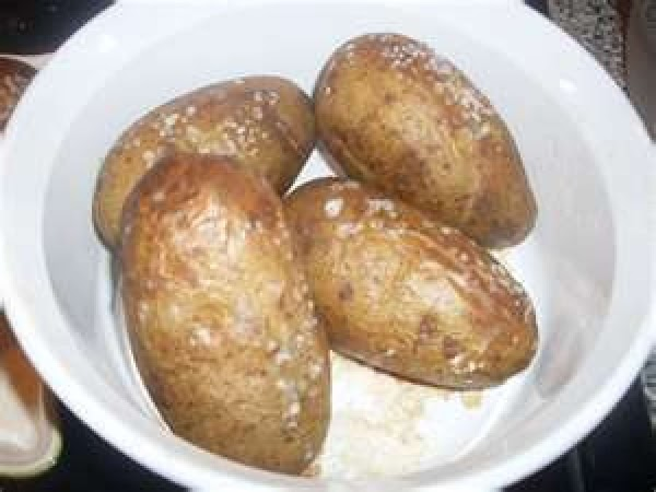 using a knife or fork poke holes in potatoes and place in microwave and...