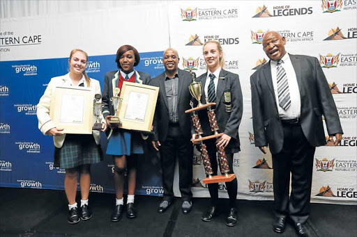 RECOGNISED: The Eastern Cape's top three matriculants were honoured at a ceremony in East London last night. From left: Moya Eybers from Clarendon (third), Sipokazi Hlalukana from Holy Cross (second) and Hanne Mertens from Pearson High (top matriculant) with premier Phumulo Masualle and MEC for education, Mandla Makupula Picture: MARK ANDREWS Picture: MARK ANDREWS