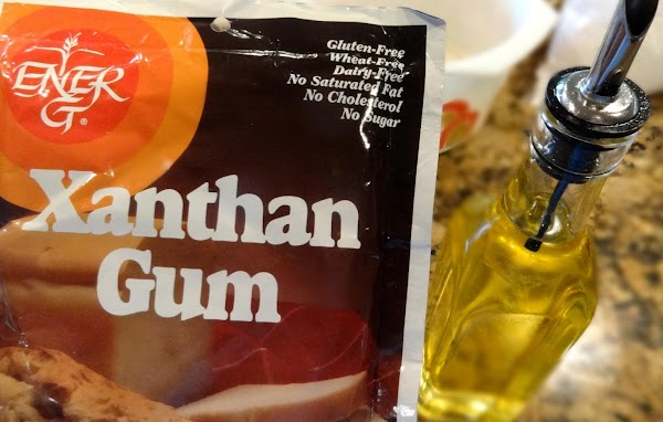 MIX THE GUM AND OIL: In a small bowl stir the xanthan gum with the...