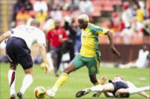 CHALLENGE: Bafana's Sibusiso Zu,a takes on oguchi Onyewu of US, during the Nelson Mandela Challenge match. Pic. Antonio Muchave. 18/11/07. © Sowetan.
