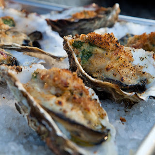 Baked Oysters with Bacon and Parmesan Cheese.