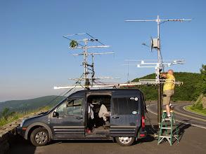 Photo: Terry W8ZN prepares microwave mast