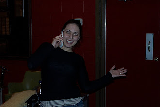 Photo: Rachel posing while talking on the phone.