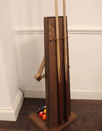 Cue Rack with sticks, a triangle and pool balls
