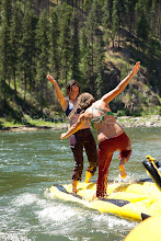 """Photo: Two young women having """"ducky wars"""" while whitewater rafting on the Main Salmon River in central Idaho."""