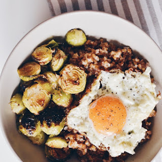 Roasted Brussel sprouts with bulgur and sunny side up eggs.