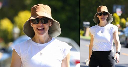 Jennifer Garner all smiles on solo stroll as ex Ben Affleck cosies up to Jennifer Lopez