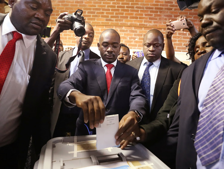 Nelson Chamisa, leader of Zimbabwe's main opposition party Movement for Democratic Change, casts his ballot in the country's general elections in Harare on July 30 2018.