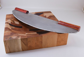 "Photo: Mike & Matt Radtke 12"" x 12"" Cutting Board and 15"" hand-made mezzaluna with turned handles [stainless, tulipwood]"