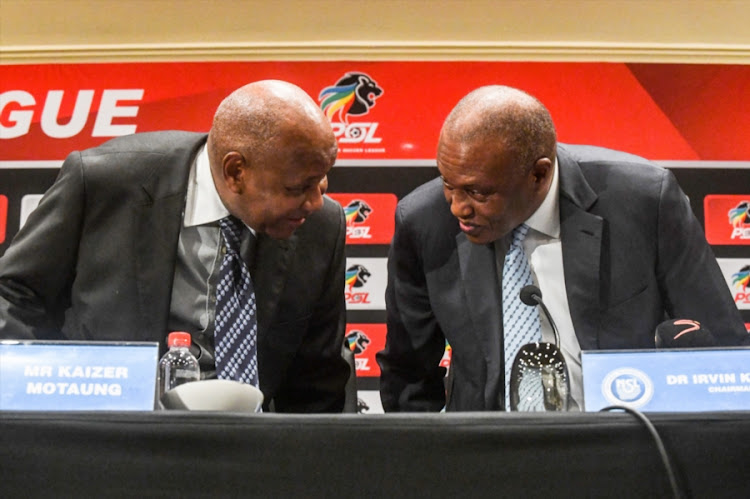 Premier Soccer League chairman Irvin Khoza (R) with the league's executive committee member and Kaizer Chiefs chairman Kaizer Motaung during a PSL press conference at Emperors Palace in the east of Johannesburg on September 20, 2018.