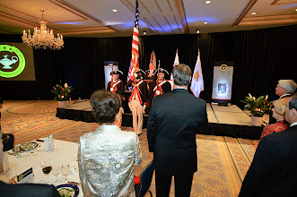 Photo: The Army Continental Color Guard from the 3rd U.S. Infantry Regiment (The Old Guard) presents the colors to the assembled guests.
