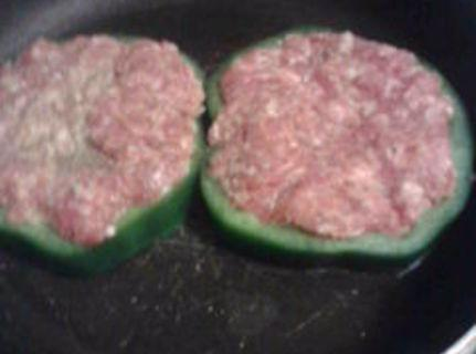 Stuff each pepper ring w/sausage. fry in tsp oil till crisp on both side. turn heat...