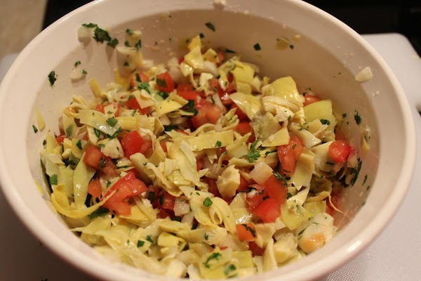 For salsa, mix artichokes, tomatoes, onion and cilantro.  Squeeze remaining lime over salsa,...