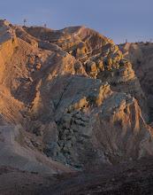Photo: Joshua trees over an eroded Mojave Desert landscape