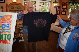 Photo: David & Kay check out a shirt at El Pinto Restaurant-