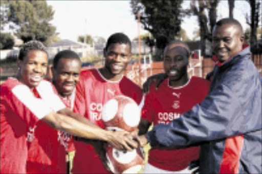 NEW BROOMS: Jomo Cosmos new players with team manager Andrew Rabutla (right) are, from left, Tornado Mongale, Mambooi Tshifhiwa, Gerald Modabi and Themba Maringa . 14/05/09. Pic. Antonio Muchave. © Sowetan.