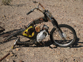 Photo: As we approached the object, we guessed it could be an old bicycle, but it turns out it was (half) a motorcycle. There were many car parts junked around this place, including many engine and echaust parts, and a gutted car seat. One wonders how these things ended up here and for how long they have been in this place.