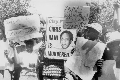 April 1993: Protestors march through the streets after Chris Hani's assassination on 14 April 1993. Secretary-General of the South African Communist Party Martin Chris Hani was assassinated on 14 April 1993. Approximately 1.5 million people participated in the protests and marches that followed his assassination. In October 1993, Clive Derby-Lewis of the Conservative Party and a Polish immigrant, Janusz Walus, were found guilty for Hani's murder, and were sentenced to death.