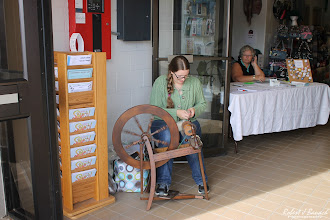 Photo: Julia, of Justifiably Julia, at her spinning wheel as Susan Childs, of Ocean City Fiber Fest, looks on...  Delmarva Wool & Fiber Expo 2015 (Fall) | Photograph Copyright Robert J Banach #oceancitycool