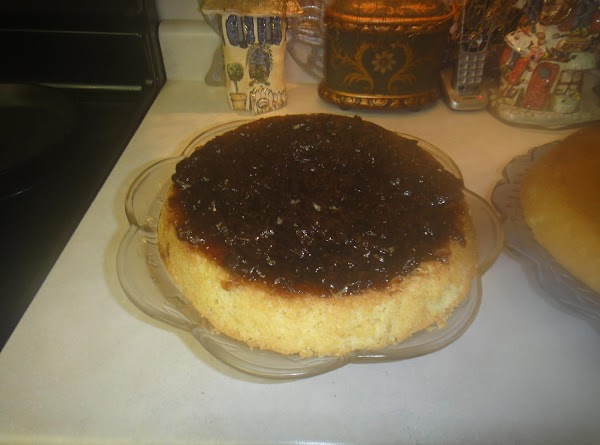When cooled add the raspberry jam to the bottom of one of the cakes.