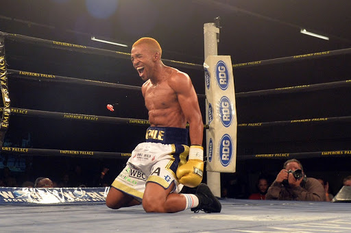 FILE PHOTO: Azinga Fuzile celebrates after knocking down Tshifhiwa Munyai during the Four go to War boxing bout at Emperors Palace on October 21, 2017 in Johannesburg, South Africa.