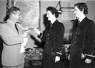 """Photo: Capt. Duffy says, """"So you're a Duffy,"""" as he greets Ensign Mary Duffy and Patricia Harris. The 1st women Naval Officers to serve at Chase Field in over 2 years."""