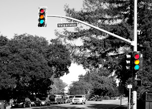 Photo: Requirement 5 (color as pictorial): Stop, slow, AND go! I layered and stacked four photos of the same traffic light, three of which were taken when the red, yellow, and green lights shone. The fourth photo was converted to black and white (thus the top layer), and I selectively allowed the other colors to show through.   On bright sunny days, with the sun shining at the right angles, traffic light colors are sometimes impossible to discern, so it may actually look like all three are on. I sometimes wish that traffic light colors were this clear (though I'd rather not have world be black and white).