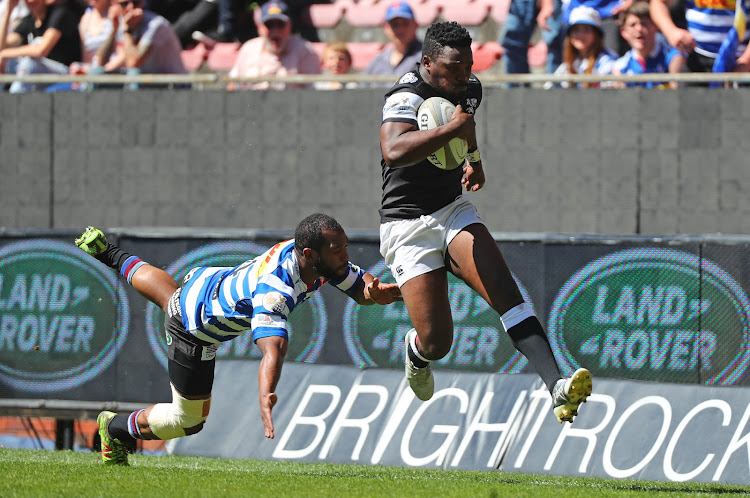 Lwazi Mvovo of the Sharks evades a challenge from Sergeal Petersen of Western Province during a Currie Cup match at Newlands Stadium in Cape Town on September 29, 2018.