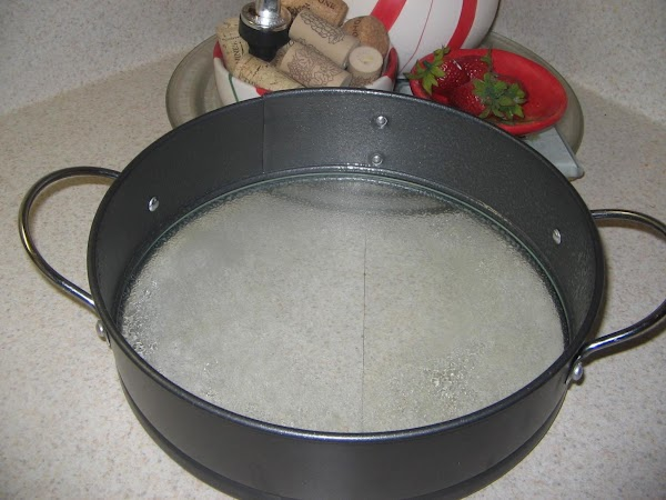 Heat oven to 350º. Spray a 10 inch spring-form pan with removeable bottom, lightly.Set...