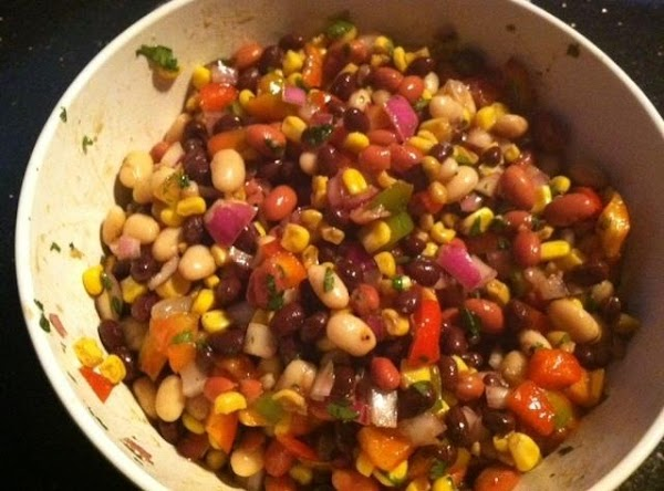 IN SMALL BOWL ADD REST OF INGREDIENTS N WHISK TOGETHER. POUR OVER BEAN MIXTURE...MIX...