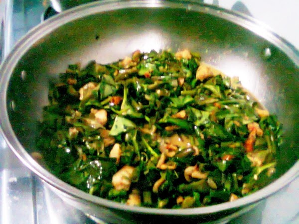 Add the water spinach or cabbage leaves and cook for a few more minutes...