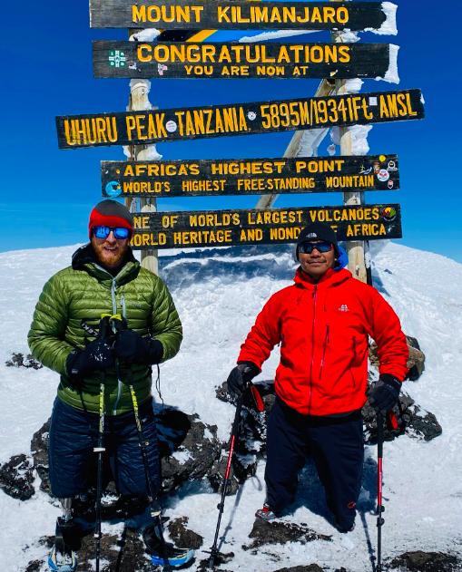 Justin and his friend, Hari, at the summit of Mount Kilimanjaro at 5895m/19341ft