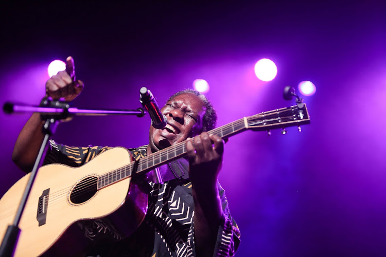Vusi Mahlasela performs a tribute at the memorial concert for Zimbabwean musician Oliver 'Tuku' Mtukudzion Tuesday at the Joburg Theatre. Mtukudzi, who died at the age of 66, released more than 60 albums over his 40-year career.