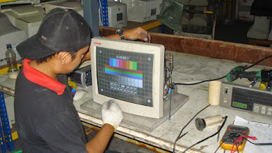 Photo: Technicians, many from former CRT manufacturing facilities, grade each monitor on an 8 point scale