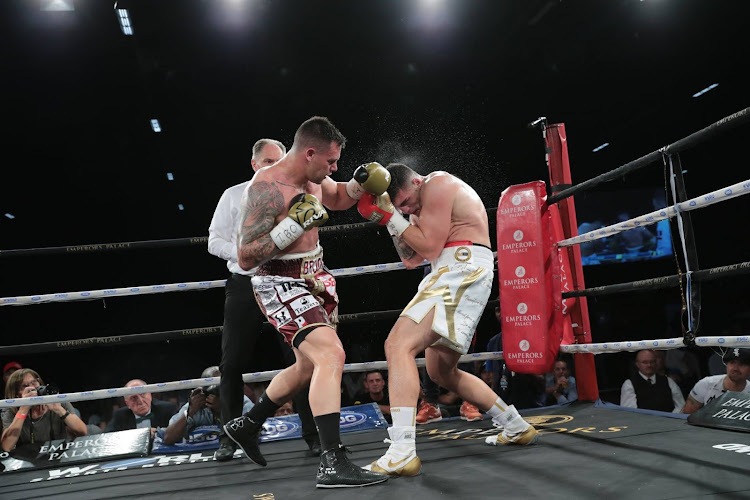 SA's IBO cruiserweight champion boxer Kevin Lerena (L) knocks down German-based Kazakhstani Artur Mann (R).