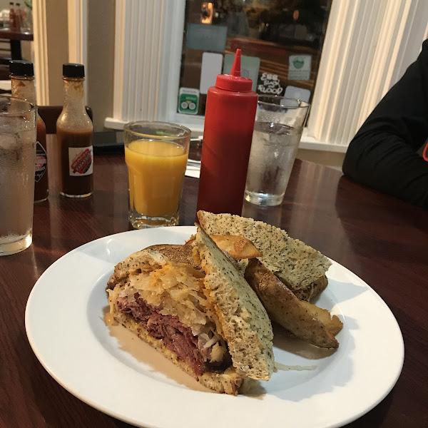 Reuben sandwich with steak fries