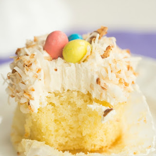 Coconut Cupcakes with Toasted Coconut Frosting.