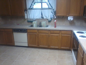 Photo: counter top installation with 24x24 Porcelain tile. on wall as back splash 5x5 stone