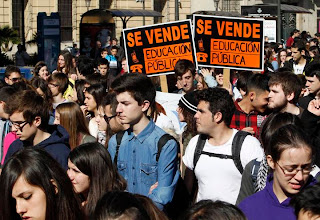 """Photo: Students march during a demonstration against the Spanish government's new education policy and alleged corruption cases, on the second day of a three-day long nationwide strike in public secondary education, in Valencia February 6, 2013. The placards read, """"For sale - Public Education"""".   REUTERS/Heino Kalis (SPAIN - Tags: POLITICS CIVIL UNREST EDUCATION)"""
