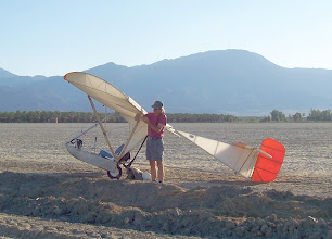Photo: For those who yearn to fly cross country in an airchair, we're back to August 2005 at the landing site of the100 kilometer Goat1 flight. The tired but satisfied pilot, Floyd Fronius, is folding back an aileron to begin the disassembly for the drive home. To get here, Floyd flew over those mountains in the background (the Santa Rosas) after crossing over the mountains on the other side of those (the Lagunas).