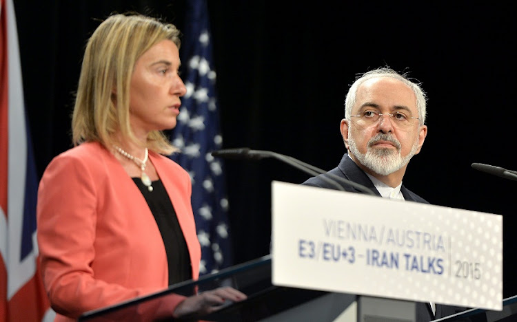 EU representative for foreign affairs and security policy Federica Mogherini, who announced the EU channel for trade with Iran (left), and Iranian foreign Minister Mohammad Javad Zarif . Picture: REUTERS/LEONHARD FOEGER