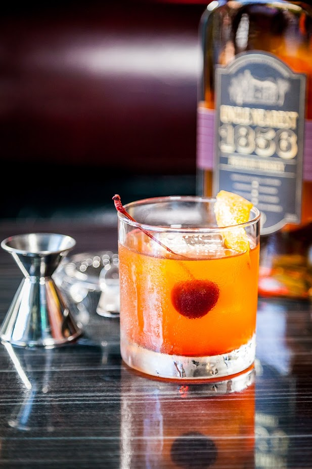 Radio Room Michelle Sumida presents My Nearest & Dearest, A Sarsaparilla Old Fashioned. Uncle Nearest Whiskey, house-infused sarsaparilla simple syrup, Angostura bitters, garnished with an orange peel and a Bordeaux cherry., photo by ALOR Consulting