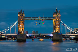 Photo: Olympic Rings on Tower Bridge - London, U.K.  Let The Games Begin! ... The Tower Bridge is one of London's most recognizable and most visited icons, but many still mistakenly call it the London Bridge. The London bridge is actually the next bridge upstream on the Thames. There is an urban legend attached to this confusion. Story has been told that when the old London Bridge was bought by Robert McCulloch in 1968, he thought he was buying the Tower Bridge. Because the actual London Bridge seemed to be falling apart, the bridge was brought to Lake Havasu in Arizona for restoration.  The Tower Bridge, a combined bascule suspension bridge with two distinct towers got its name from the nearby Tower of London.  #London2012 #Olympics #England #UK #Travel #Photography   © Yen Baet - www.YenBaet.com. All Rights Reserved. Join me on Facebook at www.facebook.com/YenBaetPhotography.